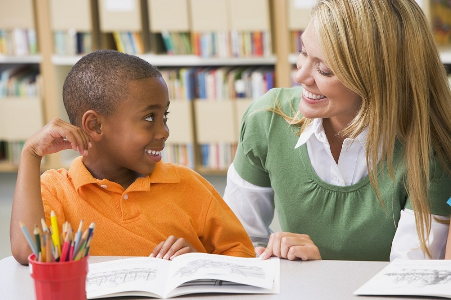 reading instruction, teacher with boy