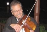 Joe Fili playing a violin