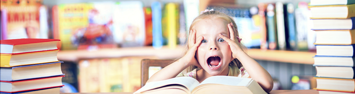 Young girls frustrated reading a book